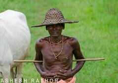Desi Cowboy (asheshr) Tags: india beads nikon cowboy indian oldman desi potrait orissa mala cowherder odisha d5100 canehat tulisbeads desicowboy potraitofanoldman portraitofavillager portrailtofacowherder