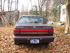 '94 LE BARON LE (richie 59) Tags: auto autumn trees usa house ny newyork overgrown car rural america sedan outside us backyard automobile unitedstates maroon country faded vacant vehicle newyorkstate chrysler mopar oldcar fwd taillights nys rustycar backend nystate rustyoldcar hudsonvalley lebaron americancar fadedpaint ulstercounty vacanthouse motorvehicle 4door mopars uscar midhudsonvalley 2013 marooncar fourdoor frontwheeldrive ulstercountyny kripplebush 4doorsedan chryslercorporation fourdoorsedan chryslerlebaron americansedan