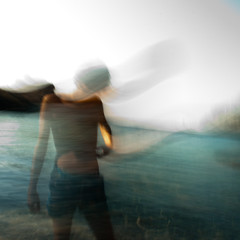 the angel with no face (Vasilis Amir) Tags: longexposure boy sea portrait seascape abstract motion blur male beach silhouette angel square moving experimental bokeh ghost move transparency faceless transparent lying icm  intentionalcameramovement mygearandme mygearandmepremium mygearandmebronze mygearandmesilver vasilisamir