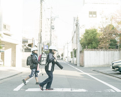The helmets (hisaya katagami) Tags: leica boys japan kids zeiss children japanese rangefinder m digitalcamera carlzeiss zm planart250 m9p