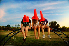 Children of the Cone (SkylerBrown) Tags: park blue girls sky orange girl strange playground evening high funny colorful cone humor humour stoned davis trafficcones cones skylerbrown
