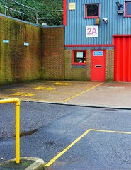 Centenary 9: 2A (teaselbrush) Tags: road park city uk red england urban abstract geometric lines yellow metal architecture iron brighton industrial estate geometry hove angles business impermanence british corrugated centenary hollingdean