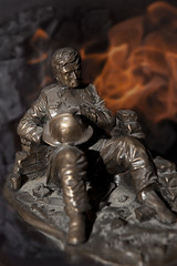 Taking a rest (Peter Trott) Tags: bronze break flames figure fireman rest firefighter
