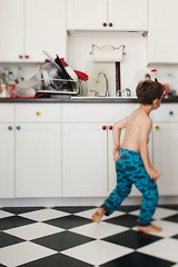 In the Kitchen (andreaheffernanphotography) Tags: portrait blackandwhite home kitchen lifestyle checkeredfloor