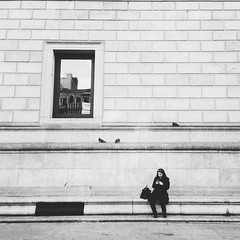 A window some pigeons and a girl texting (AnthonyTulliani) Tags: blackandwhite monochrome streetphotography iphone vsco vscocam