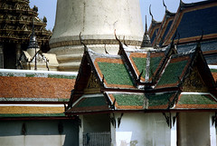 19-317 (ndpa / s. lundeen, archivist) Tags: roof color building film rooftop architecture 35mm buildings thailand temple rooftops bangkok stupa buddhist nick roofs tiles grandpalace thai 1970s 1972 19 1973 watphrakaew templeoftheemeraldbuddha finial dewolf finials nickdewolf coloredtiles photographbynickdewolf goldenstupa reel19