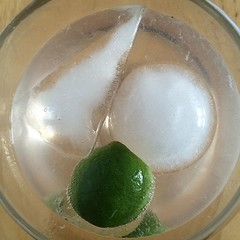 Gin and tonic featuring ice cubes in the shapes of a Star Destroyer and the Death Star.