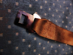 Seat Belts and Acceleration (Steve Taylor (Photography)) Tags: seat belt fabric design blue brown canvas metal chrome singapore diagonal aeroplane plane aircraft