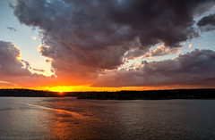 Blazing Storm Clouds (Matt Williams Gallery) Tags: mattwilliamsphotography nikon d500 landscape landscapephotography raleigh northcarolinaphotographer northcarolina fallsdam fallslake sunset clouds storm sky water lake reflection nature naturephotography glow orange