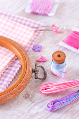 Sewing items with a check fabrics, buttons, thread and pins (♥Oxygen♥) Tags: thread pin closeup clothing pink violet craft tool cloth fabric macro bobbin design color sew work sewing tailor buttons embroidery tailoring pyalets needlework cotton needle stitch hobby repair textile material supplies equipment texture colorful set background pattern leisure cushion dressmaker darning needlecraft seamstress objects dressmaking woden table coil notebook notepad note