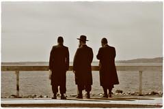 """High Holy Day"" (Alexxir) Tags: jewish men trio threereligiousmen hasidimjews highholiday holyday nearwater bythewater ocean traditional black yarmulke hat bwphoto sepia perspective bay"