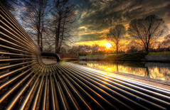 Curves (KC Mike Day) Tags: curves bench steel tubular sunset reflection sun rays pond tree loosepark park public bridge wall brick