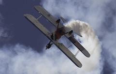 Upsidedown Wing Walker (dcnelson1898) Tags: mcasyumaairshow yuma arizona planes airplanes outdoors wingwalking smoke biplane stearman