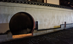 Garage door, Kyoto style (Tiigra) Tags: kyoto kyotoprefecture japan jp 2012 architdetail circle city door night shape wall wood arch