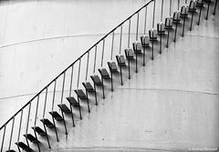 Steps (manxmaid2000) Tags: steps contrast up down monochrome peel rail stair gas tank store oil bulk diagonal wall shadow staircase metal iron steel industrial isleofman storage minimalist spiral stairs caracol gasometer