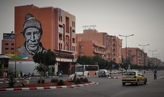 new Marrakech (SM Tham) Tags: africa morocco marrakech theredcity cityscape buildings street road vehicles cars bus streetart wallmural face