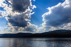 Rays (Mark Pouley) Tags: sun reflection nature water clouds landscape outdoors washington unitedstates lakes resort logcabin twinlakes rainbowbeach northtwin southtwin inchelium colvillereservation photographyforrecreation
