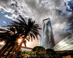 Kingdom Tower [HDR] (Bakar_88) Tags: city blue sunset urban sun sunlight building tower weather architecture modern clouds facade buildings photography design nikon flickr downtown view perspective wideangle palm architect canes architektur nikkor riyadh saudiarabia modernarchitecture hdr hdri lightroom ksa curtainwall analogy architecturalphotography architektura almamlakahtower d90 widelens olaya arriyadh modernstyle almamlakah architekturfotografie almamlaka nikond90 olaiya olaiyatown architectureinriyadh nikkor1024 depthphotography buildinganalogy canesanalogy