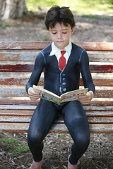 Bodypainting child with book (Eva Rinaldi Celebrity and Live Music Photographer) Tags: eye grass fruit children book books bodypainting bodyart airbrush bodypainters kids bodyartists
