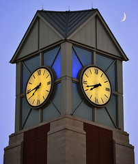 The OC clock tower with a crescent moon.