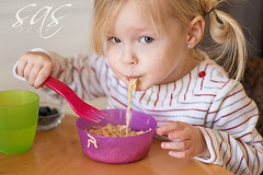(a bit of sas photography) Tags: cute girl childhood chair toddler child eating fork blonde noodles pigtails