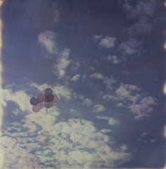 time to fly (abdukted1456) Tags: ocean sea sky woman beach me girl clouds balloons polaroid sx70 sand maine shore integral scarborough tribute expired tz timezero expiredfilm landcamera instantfilm pinepoint