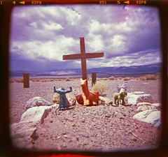 Dearly Departed (jrtce1) Tags: sky storm grave graveyard clouds square holga fuji cross desert ghost ghosttown deathvalley desolate fujichrome deathvalleynationalpark mediumformat6x6 jrtce1 holga120camera