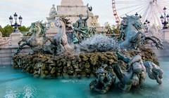 Fountain and Fair Ground (Jocey K) Tags: tour des fontaine cosmos bartholdi 6330francebordeauxplace quinconceswaterfountainbronzeswaterlampstreessculpturedetaildesignfair goundwheellampsskyla