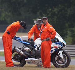 Marshals attend to Taylor Mackenzie's bike (rclenshaw) Tags: bsb supersport brandshatch marshals