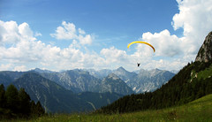 Free as a Bird (Batikart) Tags: travel blue summer vacation sky people sun holiday mountains alps flower color colour tree green nature grass weather yellow clouds forest canon landscape geotagged freedom austria tirol flying sterreich rocks europa europe peace hiking sommer urlaub natur meadow wiese wolken tranquility sunny berge adventure formation recreation geology paragliding alpen relaxation blume ursula landschaft wald baum wandern tyrol reise a610 sander fliegen achensee paraglide karwendel gleitschirm geologie canonpowershota610 100faves 2013 200faves viewonblack batikart rofangarten 201312
