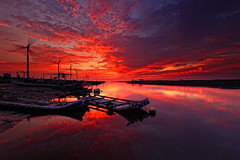 fishing bay on fire (Thunderbolt_TW) Tags: sunset sea sky sun reflection water windmill canon landscape taiwan  getty    hy windturbine gettyimages bai  changhua       hsienhsi  fave50 5d2  changpingindustryarea hybai
