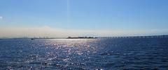 travels, open water. (eveyrae) Tags: ocean travel bridge blue light sea brazil sky sunlight tourism latinamerica southamerica water rio brasil riodejaneiro bay daylight waves ship rj sunny shore sunnyday clearskies