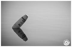 Alone. (bumpylemon) Tags: blackandwhite bw lake beach water alone solo solitary buoy