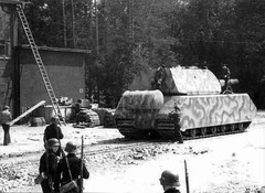 The last photo of Maus in Nazi-hands. The largest tank in the world. Weight:188t, main weapon: 128 mm KwK44 L/55 and 75 mm KwK 44 L/36.5. Front armor:240mm! (twice that of a tiger) Perhaps the best tank for defense of cities. During the war he was not involved in the fighting (an accident during transport to Berlin).