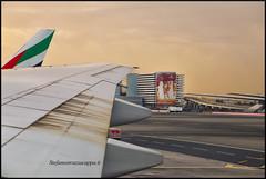 Buon Viaggio (Steven Click (Stefano Strazzacappa)) Tags: dubai aeroporto hostess pista viaggio aereo sabbia decollo cartellopubblicitario