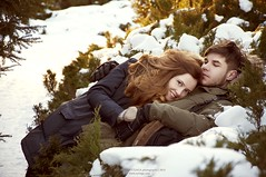 young couple hugging in the winter sun (spark of beauty) Tags: family winter sunset snow cold cute love loving season outdoors happy couple december january romance dating date february youngwoman redheaded youngman parka caucasian smitten boyfriendandgirlfriend carrotyhair