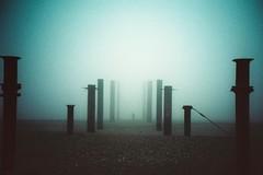 vanishing act (fotobes) Tags: mist man beach fog lca xpro crossprocessed brighton crossprocess grain shapes westpier figure analogue posts pillars brightonbeach vignette seafret kodakproektachromee100vs