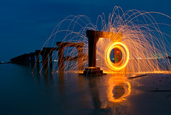 Twirl de Fun (spintheday) Tags: light sea reflection beach night glow spinning heat sparks steelwool