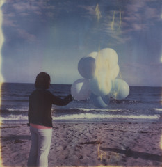 saying goodbye (abdukted1456) Tags: ocean sea sky woman beach me girl clouds balloons polaroid sx70 sand maine shore integral scarborough tribute expired tz timezero expiredfilm landcamera instantfilm pinepoint