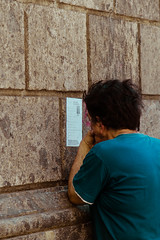 Reading carefully (Davide Restivo) Tags: street italy slr digital canon photography eos reflex europa europe italia campania read leggendo 7d napoli naples dslr carefully leggere readind attentamente