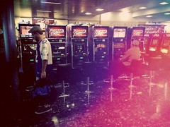 Slots In Las Vegas (Twang Your Head) Tags: people sitting sit seated lomofilter uploaded:by=flickrmobile flickriosapp:filter=lomo