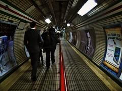 Walls Have Eyes (Doug's Lumix) Tags: uk travel red england london underground subway metro walk transport tube silhou