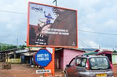 20131228-DSC_7275 (jbdodane) Tags: africa road city bicycle sign cycling mining velo vlo gabon cyclotourisme manganese cycletouring day420 eramet moanda comilog freewheelycom