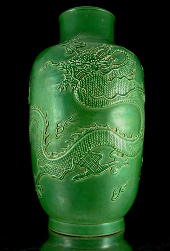 Qing dynasty monochrome green vase with incised five claw imperial dragon