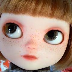 Mina's light-green eyes