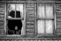 Welcome to the New Day (masisus) Tags: wood windows woman house blackwhite