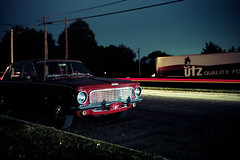 (patrickjoust) Tags: hanover pennsylvania yorkcounty utz potatochips car factory fujicagw690 kodakportra160 6x9 medium format c41 color negative film cable release tripod long exposure night after dark manual focus analog mechanical patrick joust patrickjoust pa usa us united states north america estados unidos autaut red auto automobile light streak stream trailer truck
