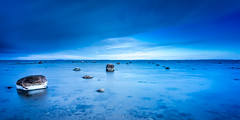 Scattered Rocks in Blue (Kurt Evensen) Tags: norway shoreline blue winter cold leefilters water longexposure sky seascape rocks sea vestfold shore