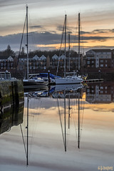 Whisper (whistlingtent) Tags: royalquaysmarina northshields reflections water masts clouds sunset houses dock boats colour orange jetty