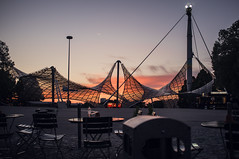 Sunset and tent roof (Adam Haranghy) Tags: camera sunset sun beer germany garden munich münchen outdoors deutschland bavaria fuji sonnenuntergang german olympia fujifilm bier olympic sonne garten kamera bavarian biergarten olympiapark olympiastadion x100